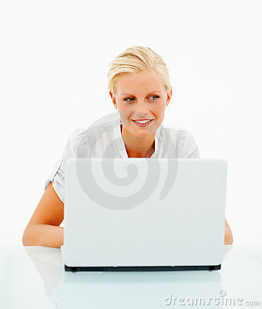 Lovely young blond female using a laptop