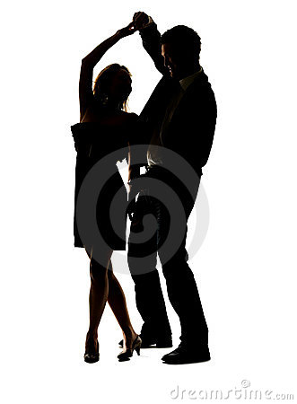Lovely young couple dancing salsa