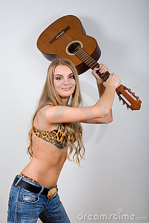Lovely young woman with guitar