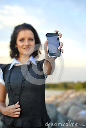Lovely young woman showing mobile phone