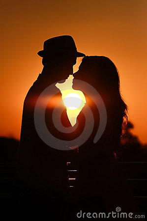 Lover couple in sunset