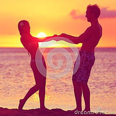 Lovers couple having fun romance on sunset beach