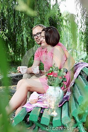 Lovers Drinking Tea on Bench