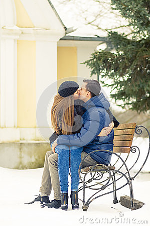 Lovers kissing on the bench