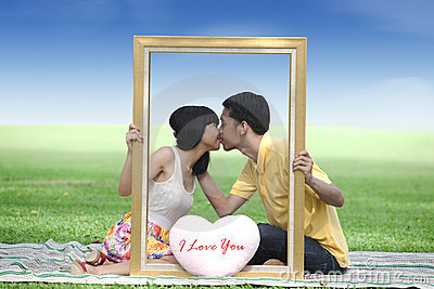 Lovers kissing in the park