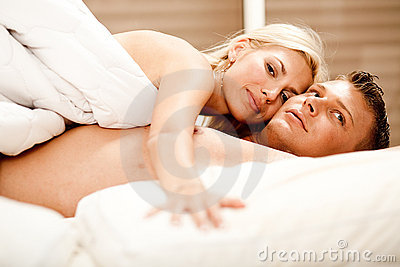 Lovers relaxing in bed