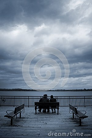 Lovers sit on a bench