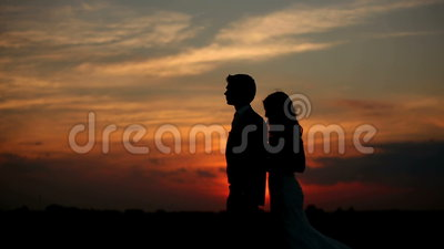 Lovers at sunset. Love couple man and woman at sunset