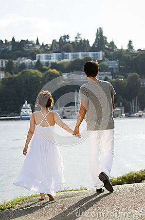Lovers Walking on Path in Harbor