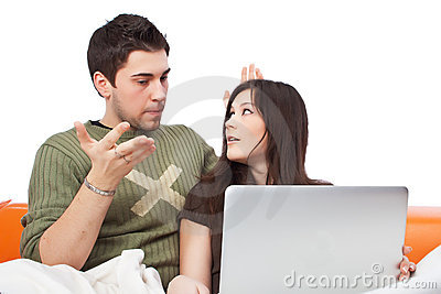 Lovers watching a movie on laptop