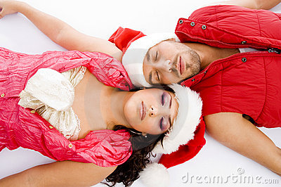 Loving american couple lying down on floor