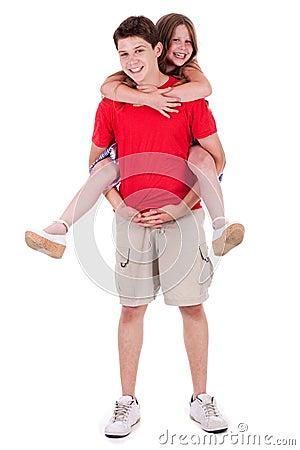 Loving brother gives piggyback