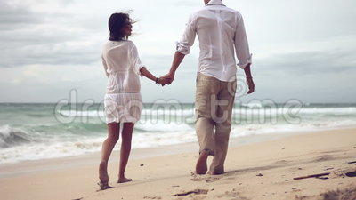 Loving couple on beach in slow motion. Loving young couple on beach in slow motion
