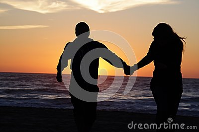 Loving couple beach sunset