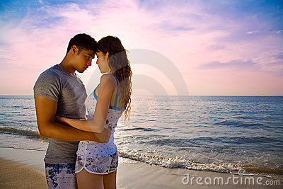 Loving couple on a beautiful sunset beach