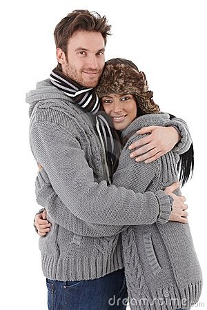 Loving couple cuddling up to each other smiling