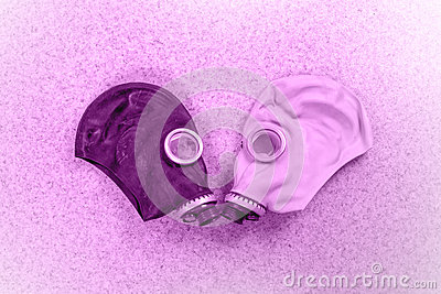 Loving couple of gas masks