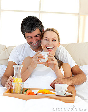 Free Loving Couple Having Breakfast Lying In The Bed Stock Images - 12812004