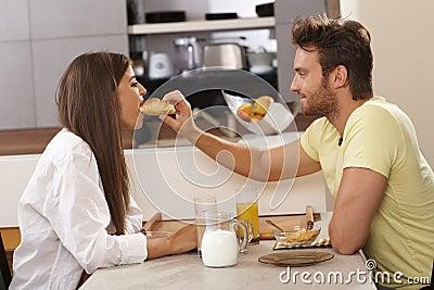 Loving couple having breakfast together