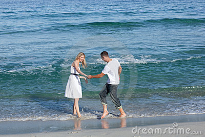 Loving couple having fun at the shore line