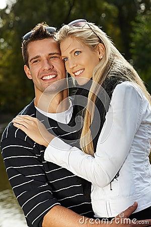 Loving couple hugging in park smiling