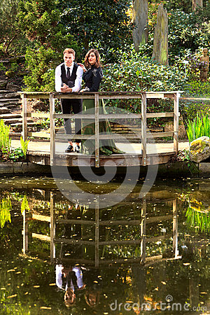Free Loving Couple In Victorian Fashion Near Lake With Reflections  In Park Stock Image - 39780601