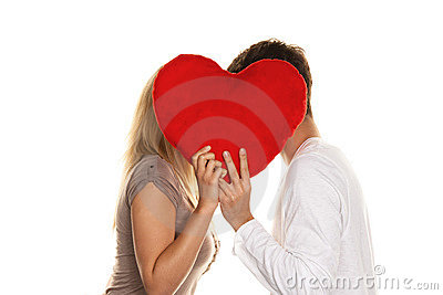 Loving couple kissing behind a heart. Love is Sho