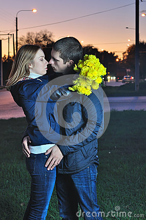 Loving couple kissing in the evening