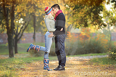 Loving couple kissing in the park