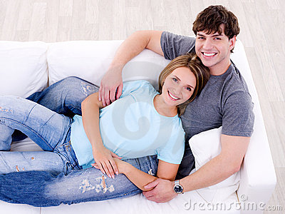 Loving couple lying together on the sofa