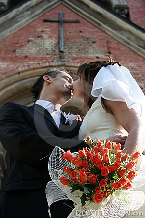 Loving couple near the church