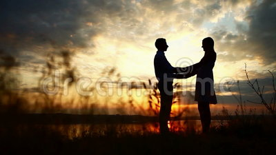 Loving couple at sunset. Sillhouette couple love at sunset