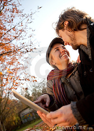 Loving couple with a tablet
