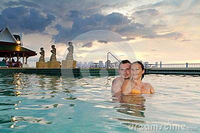 Loving couple in the tropical swimming pool