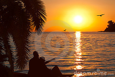 Loving couple watching beautiful sunset Stock Photo