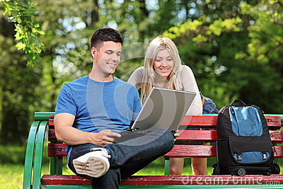 A loving couple working on a laptop