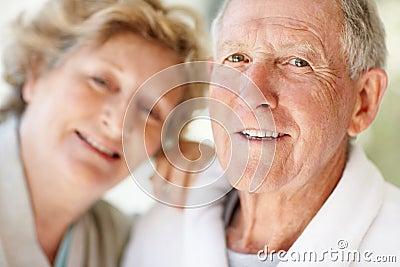 Loving elderly blur woman with a happy senior man