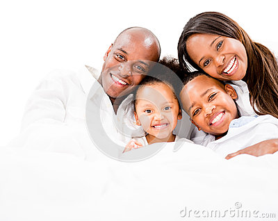 Loving family in bed