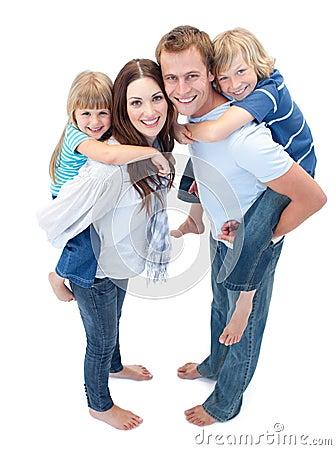 Free Loving Family Enjoying Piggyback Ride Stock Photography - 12814022