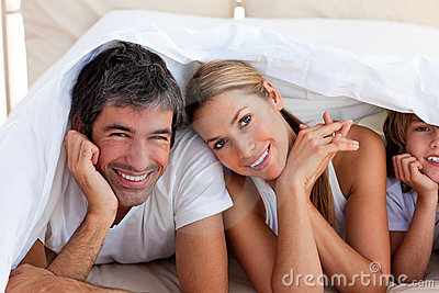 Loving Family Having Fun With On Bed Royalty Free Stock Images - Image: 12810779