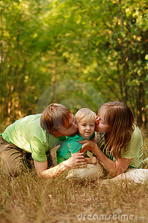 Loving family kiss