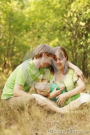 Loving family in summer nature