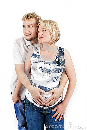 Loving happy couple, pregnant woman with her husband, isolated on white
