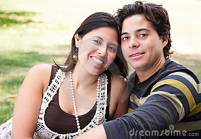 Loving Hispanic Couple Portrait Outdoors