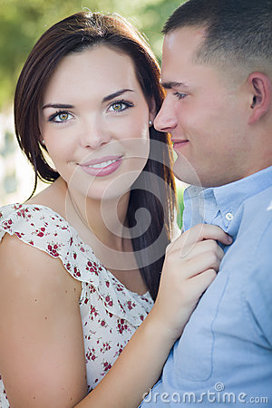 Loving Mixed Race Couple Portrait in the Park