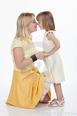 Loving mother and daughter touching their nose
