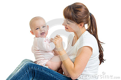 Loving mother having fun with baby girl