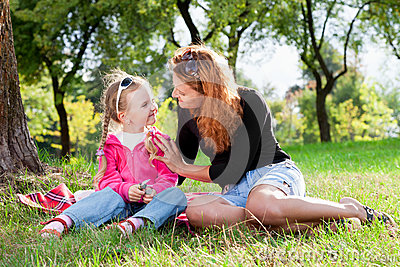 Loving mother and little girl resting