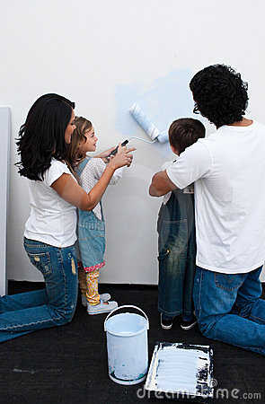 Loving parents helping their children to paint