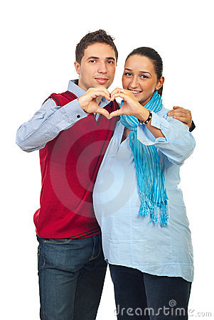 Loving pregnant couple forming heart